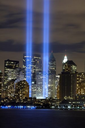 "The ""Tribute in Light"" memorial is in remembrance of the events of Sept. 11, 2001, in honor of the citizens who lost their lives in the World Trade Center attacks. The two towers of light are composed of two banks of high wattage spotlights that point straight up from a lot next to Ground Zero. This photo was taken from Liberty State Park, N.J., Sept. 11, the five-year anniversary of 9/11. (U.S. Air Force photo/Denise Gould)"